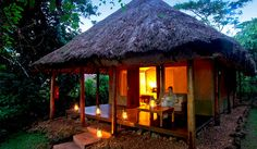 Best Uganda Wildlife Lodges - The origional luxury tented camp in Bwindi and a favourite for the Gorilla families to visit! Tropical House Design, Tropical Houses, African Jungle, Hut House, Wooden Hut, Forest Camp, Unusual Hotels, Luxury Tents, Camping Places