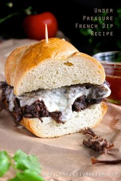Under Pressure French Dip Sandwich Recipe from Confectionalsim (technically a pressure cooker recipe, but would adapt very readily to crockpot, all day on low)