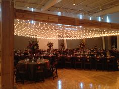 Rustic rehearsal dinner with Italian lights and bright mixed color flowers. Available for rental @ https://hollidayflowers.com