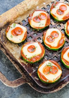 These Grilled Zucchini Pizza Bites are a healthier way to indulge your pizza craving! This low carb snack makes a great grilled appetizer for parties and is a fantastic use for that overabundance of summer zucchini.