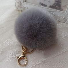 Gray PomPom/FurBall Bag Charm/Keychain This Gorgeous Pom Pom will give a fantastic look to your bag or keys. FAUX Rabbit Fur Biutique Bags