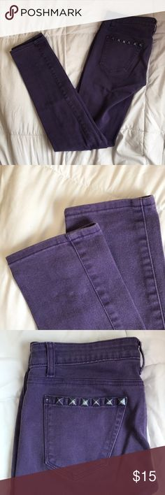 Purple skinny jeans! The jeans themselves are really good condition, no stains or tears. Studs show signs of wear and one is missing (pictured). No wear on cuffs or waistband Rue 21 Jeans Skinny