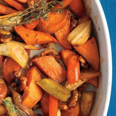 Honey-Roasted Vegetables Recipe with sweet potatoes, carrots, parsnips, walnut halves, honey, extra-virgin olive oil, coarse salt, ground pepper, thyme