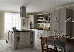 The Fairford Cashmere kitchen has a cashmere Shaker style door with a wood grained detail. Create a uniquely stylish kitchen with a range of Howdens appliances, flooring and other kitchen accessories. New Kitchen, Kitchen Dining, Kitchen Decor, Stylish Kitchen, Dining Table, Kitchen Cabinet Design, Kitchen Cabinetry, Kitchen Designs, Shaker Style Kitchens