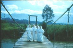 Sisters Mary Marisa, Mary Alexia, Mary Claver and Mary Magdelida, Sisters of Notre Dame, Toledo Province crossing the Waghi River in the Highlands of Papua New Guinea, shortly after arriving to establish a mission in 1961. #HistoryNun #NCSW http://www.sndtoledo.org