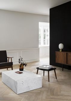 Norm Architects resurrect a historic Copenhagen Apartment that once housed Danish Designer Poul Henningsen and was devastated by fire, for a classically modern and minimal family abode. Apartment Interior Design, Living Room Interior, Modern Interior Design, Interior Architecture, Living Room Decor, Living Area, Living Room Tables, Monochrome Interior, Parametric Architecture
