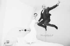 Bride & Groom jumping on the bed in their hotel room | Lofts on Pearl at the Webb Building | Buffalo Wedding Photography
