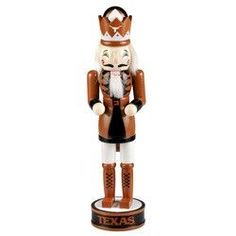 This officially licensed Nutcracker is a great way to show off your favorite team this holiday season. This 14-inch wooden hand-painted nutcracker features the colors and logo of your favorite team. M