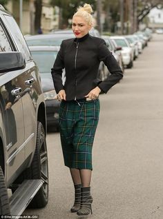Solid and patterned: Gwen layered a black jacket over a turtleneck sweater, paired with a ...