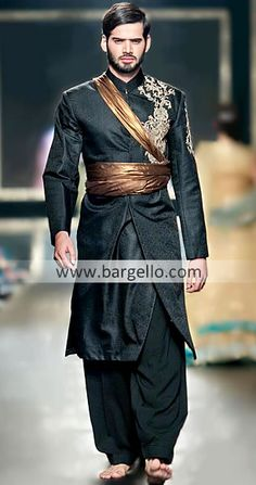 Men's Fashion, knee length coat that opens to reveal fitted pants below a gold or copper colored belt