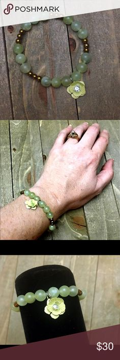 🎉HP🎉Green Serpentine + Hematite Bracelet I designed this semiprecious gemstone stretch bracelet with the intention of helping with memory. It's made with natural Serpentine and magnetic gold Hematite featuring a green flower charm.  These stones have various healing properties other than anxiety.  Please Note: The use of gemstones is not meant as a substitute for medical or psychological diagnosis and treatment Handmade Jewelry Bracelets