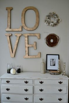 love this LOVE. Would be great in an upstairs hall or guest room. Lg letters at JoAnns. Finish w metallic paint and stain