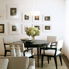 All white frames make the gallery wall in this Central Park West residence feel clean and well-edited. When creating a gallery wall, it's important to have one constant - frame size, frame color, etc - to ensure it feels deliberate and elegant Interior Design: Groves & Co