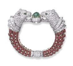 "A SPECTACULAR DIAMOND, EMERALD AND RUBY ""LION-MASK"" BRACELET, BY BULGARI"