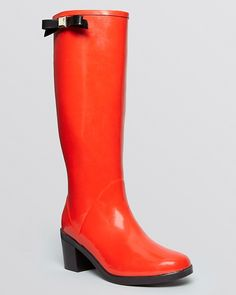 $104, Red Rain Boots: Kate Spade New York Rain Boots Romi Bow. Sold by Bloomingdale's. Click for more info: https://lookastic.com/women/shop_items/146691/redirect