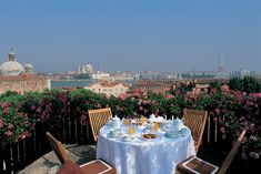 A private breakfast on a roof top terrace of a Suite Lagoon View & Balcony