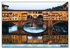 Florence, Italy--Built in 1345, Ponte Vacchio was Florence's first bridge across the Arno River and is the only surviving bridge from Florence's medieval days (others were destroyed in World War II).