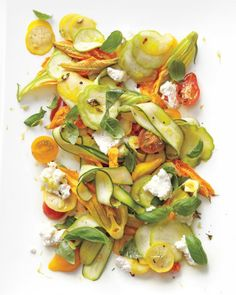 Shaved-Squash Salad with Tomatoes, Zucchini Blossoms, Ricotta, and Thyme Oil (via brit + co)