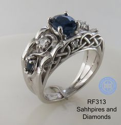 Unique Celtic Irish engagement wedding ring in 14K White Gold with diamonds and Sapphires. Elegant cathedral setting with diamonds set on the side of the ring.