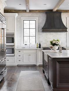 White cabinets, dark island, wood floors, wood beams,