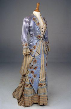 Undated turn of the 19th century Floor length, Light blue pin stripe with orange and tan floral details.