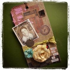 This is my #12TagsOf2015 entry for the #TimHoltz tag challenge that I made my New Year's Resolution (hey, they don't have to be hard or challenging resolutions!). On my blog it talks about the main components of the tag, but my favorite part is the old paper rose. That thing came out great!