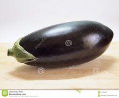 An eggplant on a desk