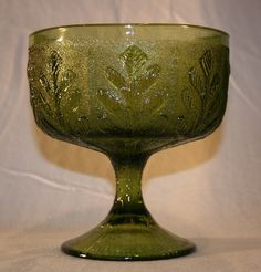 This Vintage Green Pressed Glass Leaf Pattern footed vase is in excellent condition, having no chips, cracks, or deterioration of any kind. Markings: F. c 1978 Measures: 5 Diameter, 5 Ta Vintage Green Glass, Red Glass, Glass Art, Milk Glass, Vintage Dishes, Antique Dishes, Antique Glassware, Old Bottles, Pressed Glass