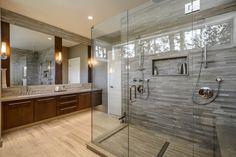 rahmenlose glas duschwand bereich fliesen stein holz optik