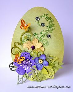 Handmade card for Easter, egg-shaped in green with purple and orange flowers.