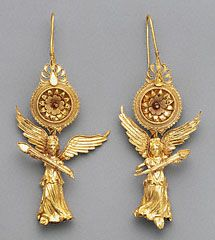 NIKE WITH OLYMPIC TORCHES. Earrings with Nike Pendants, Greek, 225-175 B.C. Bruce White Photography. Gift of Barbara and Lawrence Fleischman