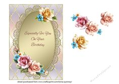 A 5in x 7in card front which has a pastel multicoloured background and a gold trellis pattern, and a lace edged gold topper.  The topper is decorated with layered peach, pink and gold roses, and also has a birthday greeting.