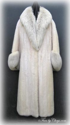 SOLD! Vintage Tourmaline Mink and Amber Fox Fur Coat #TMF704; Very Good Condition; Size range: 4 - 8. This is a magnificent vintage genuine tourmaline mink fur coat with stunning very full and fluffy amber fox collar and cuffs. It features a gorgeous, very large amber fox shawl collar and large belled sleeves with amber fox slanted cuffs. You just don't see furs like this one everyday! You will wow the crowd when you wear this tourmaline mink coat and as a bonus, you will feel sensational!