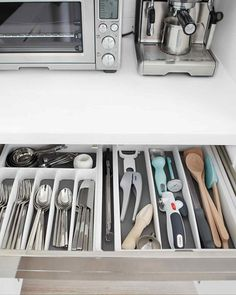 There's a lot that goes on in your kitchen, so it's especially important that it be organized. Here are 18 ideas that will keep your cabinets and countertops clean and uncluttered, so you can focus on the important stuff, like cooking, and, of course, eating.