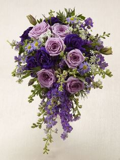 The FTD® Lavender Garden™ Bouquet is blooming with majestic charm, set to add that extra touch to your wedding style. Lavender roses are offset by purple larkspur, purple double lisianthus, lavender m wedding extras touches Purple Wedding Bouquets, Bride Bouquets, Bridal Flowers, Flower Bouquet Wedding, Floral Bouquets, Floral Wedding, Purple Flowers, Bridesmaid Bouquets, Bouquet Flowers