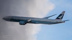 Cathay B777 about to penetrate some dark clouds
