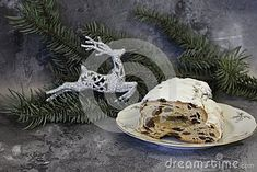 Stollen cake on a plate with pine-wood