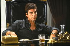 """I'm not advising you to dress like Tony Montana, but some of you will anyway. So please do it right, like Al's doing here. A thin gold chain. Just two buttons undone. And black silk. Not, like, chartreuse, okay? Except if you really are a vicious Cuban druglord. Wear whatever you want. I respect that. From """"Scarface."""""""