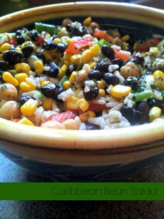 Light and Healthy side with black beans, garbanzo beans, corn, and other vegetables in a red wine  seasoned marinade.