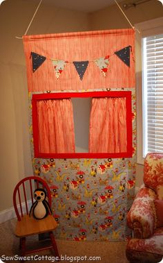 Fabric puppet theater: about 3 1/2 yards of fabric, two dowels, two large eyelets, iron on pellon, two flat wooden rods to reinforce the window, and wonder under for the bunting