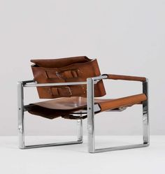 Émile Souply; Chromed Metal and Leather Lounge Chair for the Brussels Hilton Hotel, 1965.