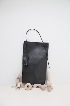 building block ~ Perfect picture. A great black bag is an essential building block for every woman's closet.