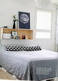 Scandinavian bedroom with interesting headboard.