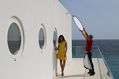Behind the scenes of Vogue Photoshoot with Vera Filatova in Foros Yacht House by www.robinmonotti.com  Hair and make-up by Theo Dekan Vera's wearing Yellow Dress and Black Sandals both by Alexander McQueen