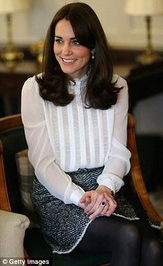 The Duchess is pictured at London's Kensington Palace today