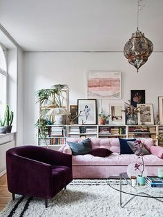 Entrance living room Blush velvet sofa. Bookshelf behind.  SUMINTRA | thezoereport:   We love a good velvet chair. It...