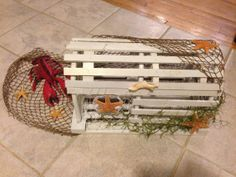 Lobster trap escort card holder. Would look great with DIY blue ...