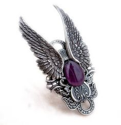 Silver Angel Wings Ring with Purple Cabochon    This is a very large and impressive ring adorned in Gothic darkness and elegance. Two large life-like