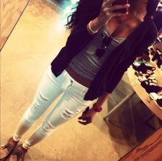 Distressed white skinny jeans.
