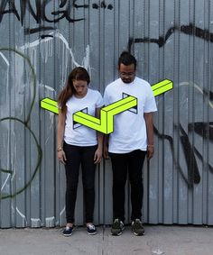 Florescent Geometric Illusions Skewering People in Brooklyn - The last time we featured the work of artist Aakash Nihalani, he was using florescent tape to create impossible geometric illusions all over the urban landscape. Now he's using that same tape to skewer the hip people of Brooklyn with angular geometric forms. Window-like holes provide easy passage through the chest and stomach of each of his subjects… | by Benjamin Starr June 24. 2014